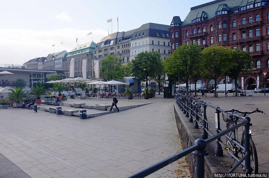 улица Jungfernstieg,большие дома -магазины