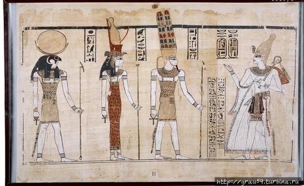 На папирусе, хранящемся в Британском музее изображены слева направо боги из Фиванской триады : Хонсу, Мут, Амон. В левой руке боги держат скипетр, в правой анх, один из наиболее значимых символов древних египтян. Считался символом вечной жизни и его клали  в гробницу фараонам, чтобы после смерти их души смогли продолжать жизнь в загробном мире Древнего Египта — Дуате. Вместе с ними изображен фараон Рамзес III (крайний справа).Фото из Интернета