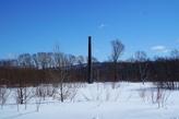 Таких одиночных дымовых труб на юге Сахалина великое множество.Все, для чего они служили, разрушилось, их можно свалить разве что ракетой Тополь.