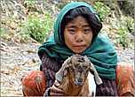 Долго не могла понять, то ли это девочка, пасшая овец, то ли маленькая росточком женщина с усталым лицом