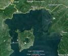 Остров Талисай с двумя кратерами —  Binintiang Malaki Crater (слева вверху) и Taal с озером в центре