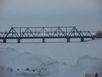 Железнодорожный мост через реку Сызранку, а за ним Волга.