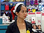 *Заглянули ненадолго в огромный торговый центр. Был еще ноябрь, но головы всех продавщиц украшали новогодние шапочки