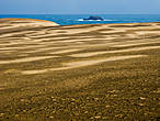 Дюны примыкают вплотную к океану.