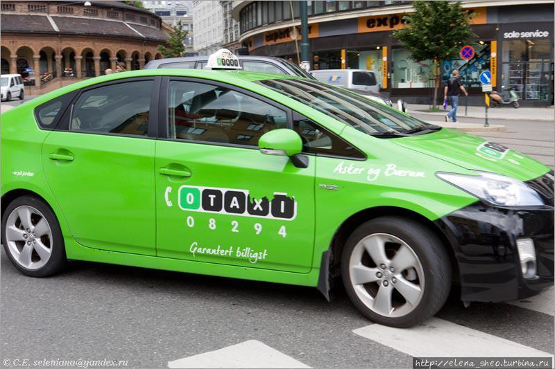 14. А вот такси зелёного цвета, ещё приятнее! Наверно, это такси двух разных фирм.