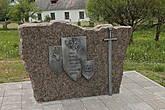 Здесь же памятный камень о героическом участии Волковыской хоругви в Грюнвальдской битве — многие тогдашние историки упоминали о подвигах жителей этого городка.  И не зря! Говорят жители Волковыска специально пошли отомстить крестоносцам за разрушенный ими город.