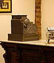 Стариный кассовый аппарат и прилавок из черного дерева с резьбой.1874 год.
