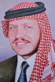 И портрет его сына, нынешнего короля, Абдаллы ибн Хусейна.