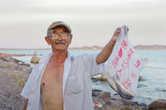 Этот дедушка приехал с Алматы порыбачить на выходные. Сетовал, что рыбы все меньше и меньше с каждым годом