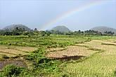 Когда дождь прошел, мы увидели радугу. Приподняв сизые облака, разноцветная дуга подпирала небо.