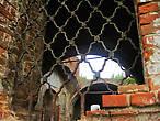 Церковь Успения Богородицы. За решеткой — свобода или запустение?..