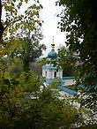 Колокольня с оградой мемориальной зоны кладбища XIX века возле храма Антония и Феодосия Печерских